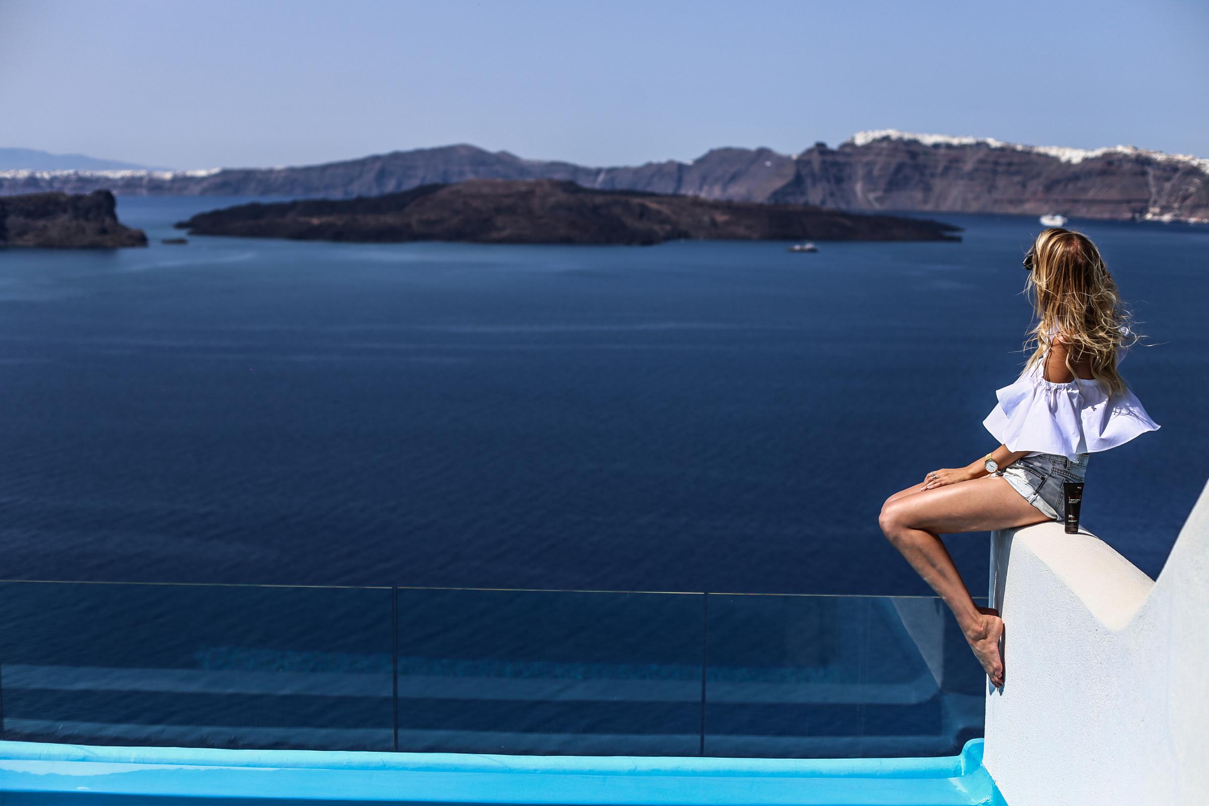 Blue shades & tan lines | Santorini