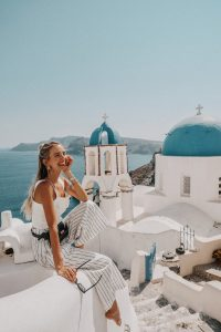 White outfit and black accessories Santorini