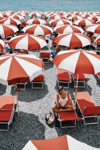 Hunza G white bathing suit and umbrellas