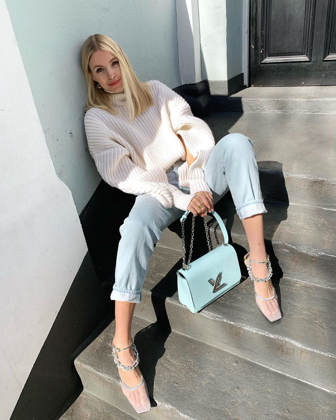 Cream sweater and denim look for spring